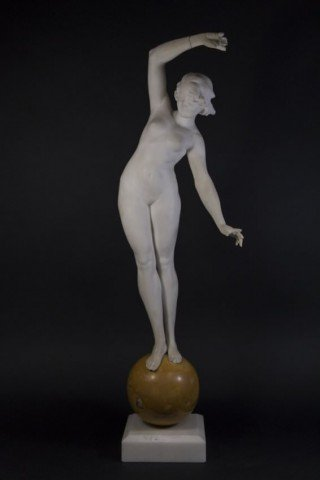 An Art Deco Carved Marble Figure of a Nude Dancer