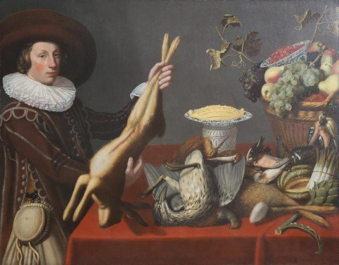 A Game Still Life with a Young Man Holding a Hare in front of a Table with other Victuals,Dutch, 1st half 17thc.
