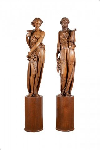 Pair of large, rare, superbly carved, butternut wood figures representing Europe and Africa