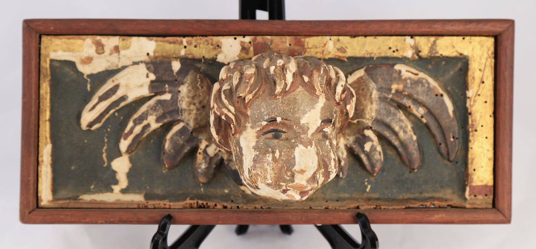 Pair of carved wood cherubs heads, Italian, 18thc.