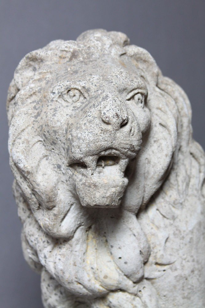A Cast Stone Figure of a Lion by 20th Century School