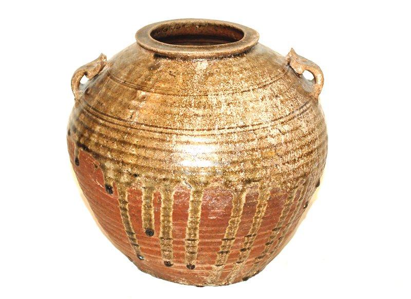 A Chinese Drip Glaze Urn, Jin or Han Dynasty