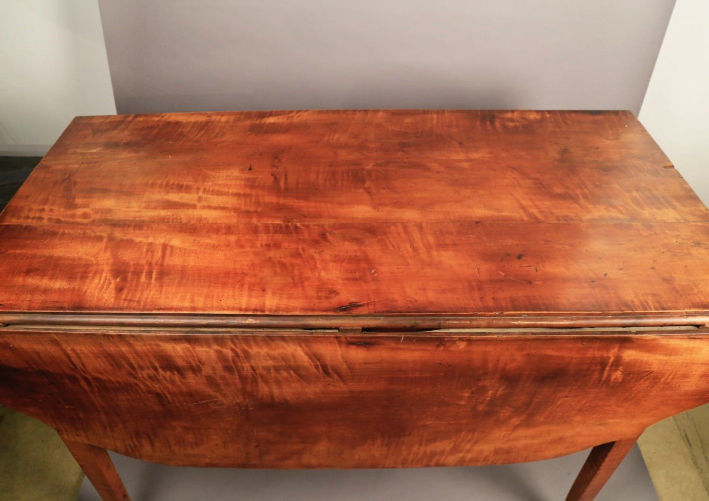 An American Federal or Sheraton Tiger Maple Drop Leaf Table, 19thc.