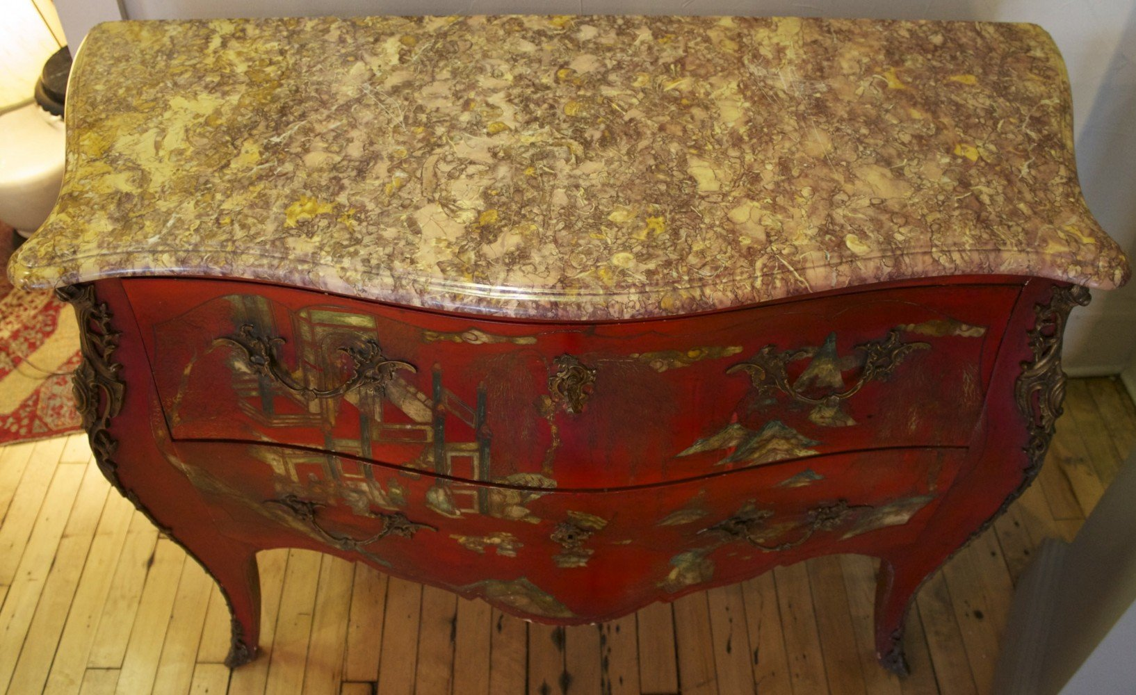 A French Pagoda Red Lacquered Bombe Commode