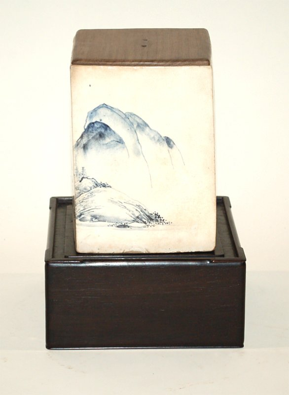 A Japanese Ceramic Water Jar With Landscape