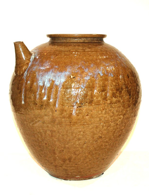 A Japanese Glazed Pot With Spout
