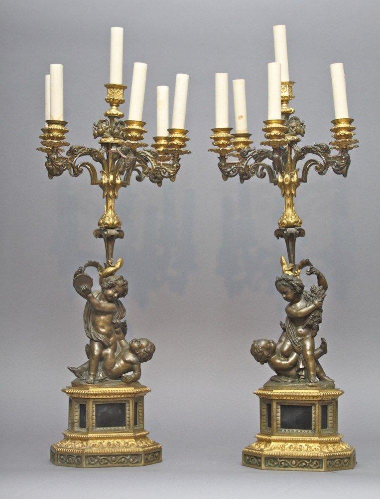 A Pair of Bronze and Gilt Bronze Candelabra