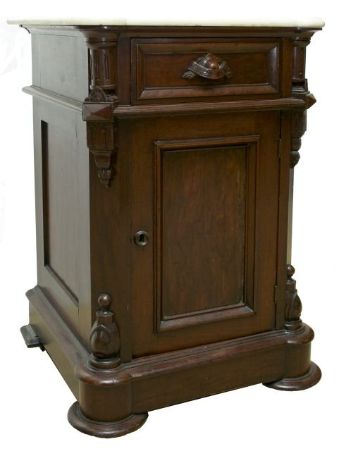 A Victorian Carved Walnut Side Cabinet With Marble Top