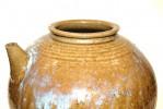 A Japanese Glazed Pot With Spout